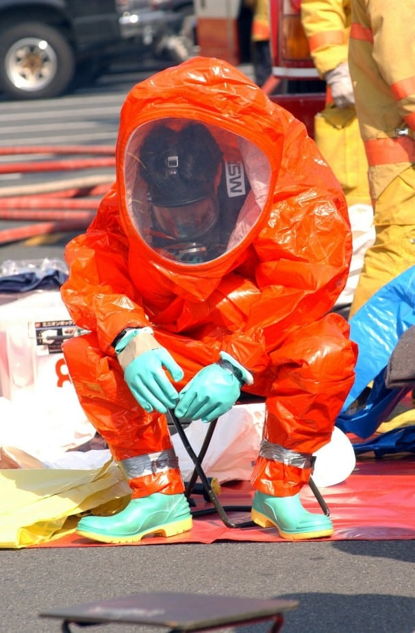 firefighter in hazardous material suit