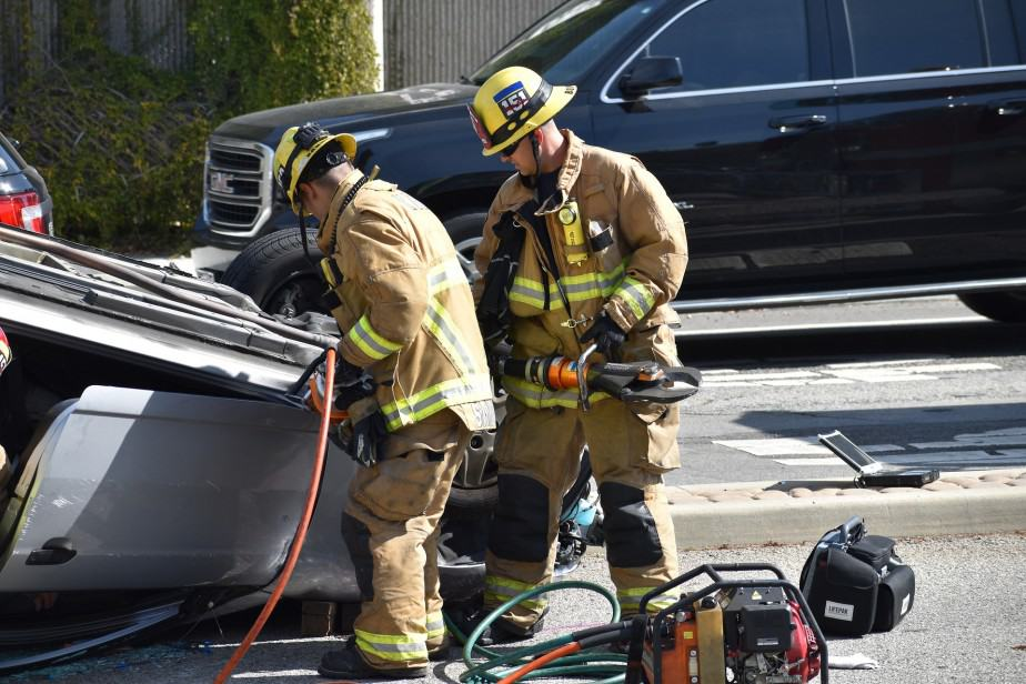 firefighters using extrication tools