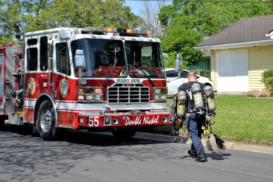 firefighter carrying SCBA packs